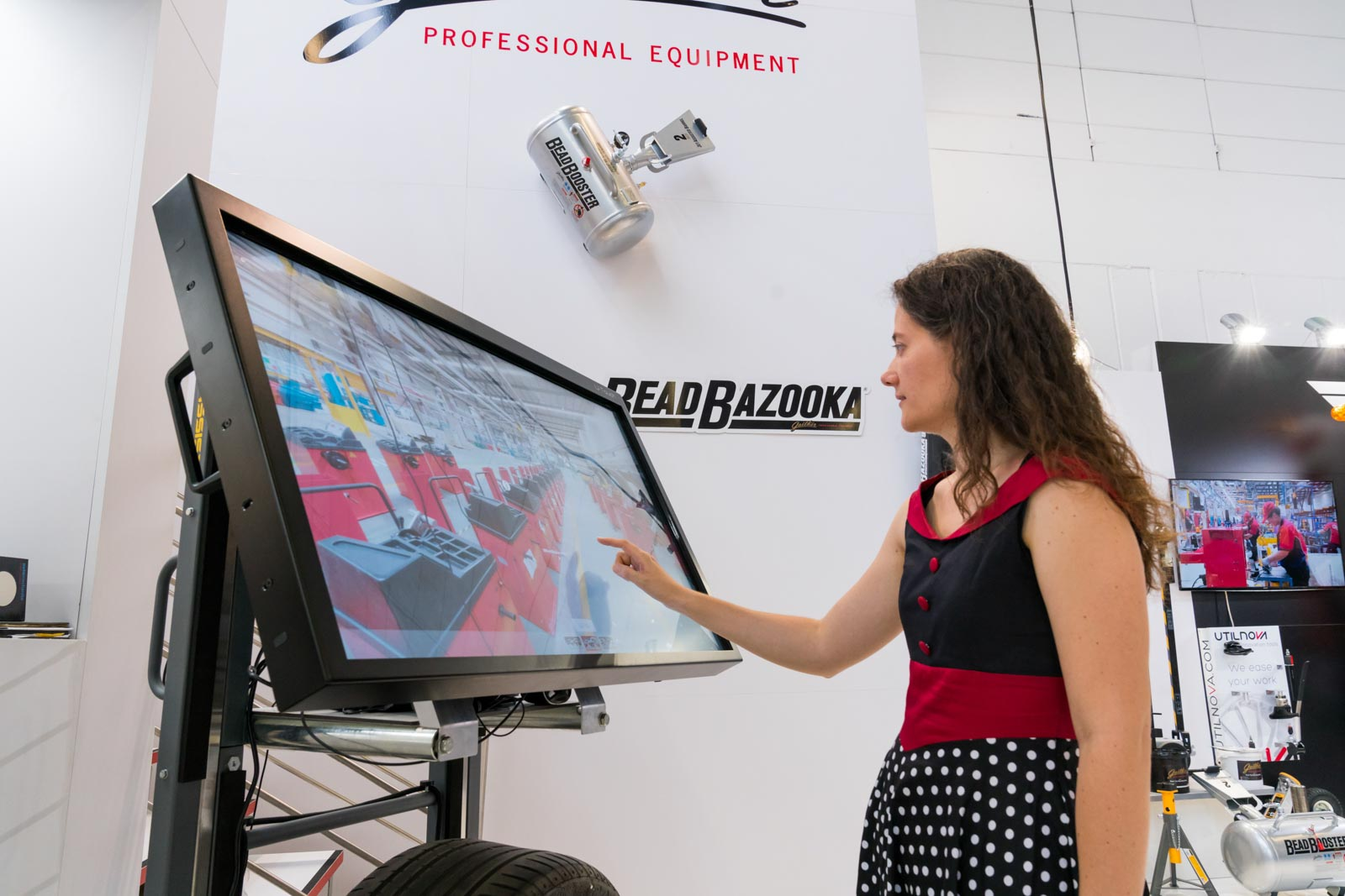 Marije looking at a touchscreen monitor